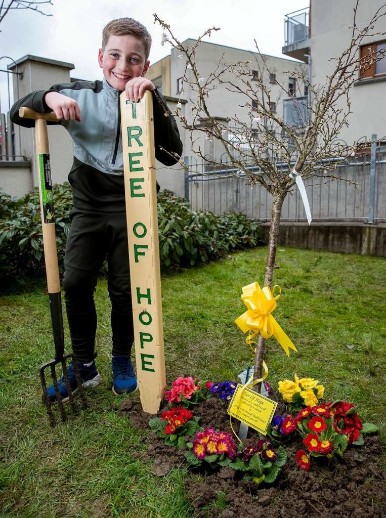 29/3/18 ***NO REPRO FEE*** Craig O'Rafferty aged 12 a resident at the Respond social housing development in Tallght pictured at the planting of a tree of hope this morning Pic: Marc O'Sullivan